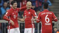 Robert Lewandowski helps Bayern Munich back to top as RB Leipzig lose