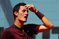 Dizzy Bernard Tomic spins out of French Open