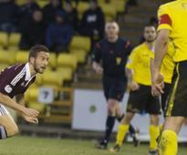 Freed Hearts midfielder Kenny Anderson plots UK return