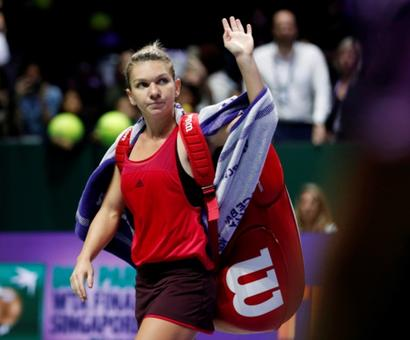 Halep shakes off disappointment of latest Singapore flop