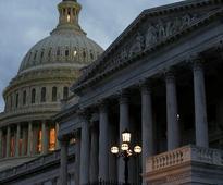 European stocks edge down as US Senate approves tax bill