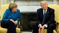 That's how Donald Trump Makes America Great Again: Twitter launches into Trump-Merkel 'handshake'