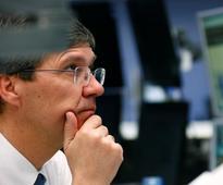Telcos, banks lift European shares, dollar dips