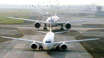 As skies congest, airlines grab parking slots