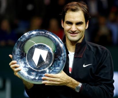 Federer cruises past Dimitrov to claim Rotterdam title; Kvitova stuns Wozniacki