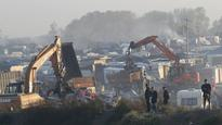 France tells migrants to forget Calais as 'Jungle' camp razed