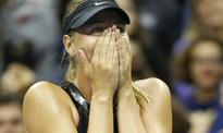 Sharapova sees off Babos to extend New York stay