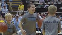 Kid casually drains 3 half-court shots in a row
