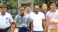 Three Nigerians, woman running fake lottery arrested