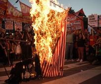 Photos: Leftists Burn American Flags to Protest Obama in Argentina