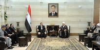 Khamis, al-Moallem meet delegation of religious figures from Iran