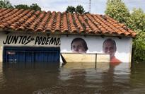 Torrential rains, flooding kill at least 10 in South America