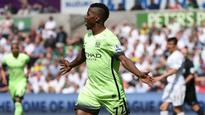 Man City limp toward Champions League after draw at Swansea