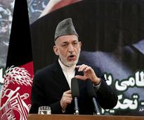 Karzai suspends talks with US over Taliban move