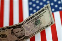 Tax deal sends dollar surging, preps US stocks for strong day