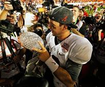 Alabama's broken BCS title trophy auctioned off