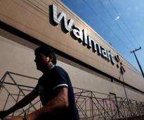 Wal-Mart trims sales forecast