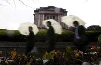 Nikkei erases gains and slips after BOJ's easing decision