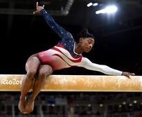 Simone Biles Tragic Childhood Turns Into Olympic Gold, And A Love Story With Zac Efron