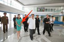 South Korea to North Korea: KIM JONG UNS WIFE CARRIES A REALLY EXPENSIVE PURSE!