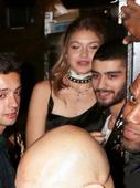Bleary-eyed Gigi Hadid nuzzles Zayn Malik as loved-up couple leave star-studded 21st birthday bash in Los Angeles