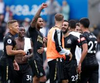 Premier League: Jamaal Lascelles hands Newcastle United narrow victory over Swansea City