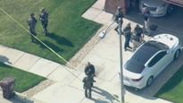Two FBI agents wounded near Chicago; subject of warrant found dead