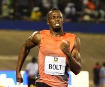 Usain Bolt breezes into semifinals at Jamaican Trials