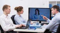 What are the business benefits of video conferencing?