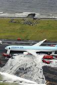 Passengers evacuate as fire hits Korean Air jet at Haneda