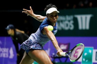 Evergreen Venus rallies past Garcia to set up Wozniacki final