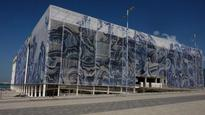 Why is the aquatics venue wrapped in art?