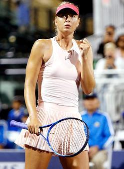 PHOTOS: Sharapova struggles but advances on return