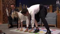 Kristen Stewart bends over backwards to please Jimmy Fallon by playing Jell-O Shot Twister with him on The Tonight Show