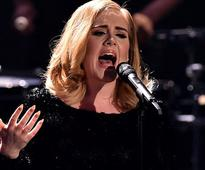 Adele broke her Album of the Year Grammy in two