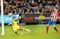 Godin strikes as Atletico beat Spurs
