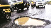 Western Express Highway potholes: PWD cares only about money from hoardings, not repairing roads, says Sena