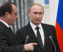 Putin calls off visit to France amid Western outcry over Aleppo attacks