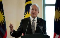 Malaysian police target online critics of prime minister