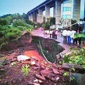 Road caves in, traffic hit as pipeline leaks