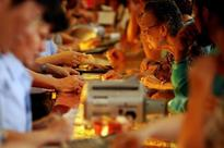 Indian jewellers stock up gold for weddings; rising prices cap demand elsewhere