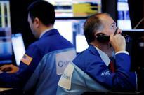 S&P, Dow fall with health stocks; Microsoft lifts Nasdaq