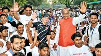 Sports minister flags off marathon for slum youths