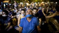 Spain fines journalist over arrest photograph under 'gag law'