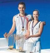 English badminton couple takes winners podium