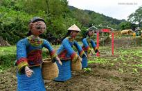 Tourists visit scarecrow exhibition in central China's wetland park