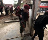 Burqa-clad militants storm college in Pakistan's Peshawar, 14 killed