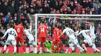 Struggling Swansea strike stuns Liverpool
