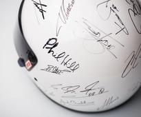 Helmet signed by every living F1 champion since Phil Hill heads to auction for charity
