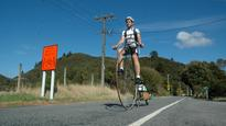 Penny-farthing rider at home in Upper Hutt's valleys